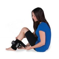 Woman applying Ice20 ankle compression