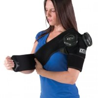 Woman applying ICE20 Double Shoulder Ice Compression Therapy